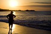 Tourists walking the beach during sunset, Galapagos — Stock Photo
