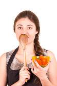 Beautiful young girl eating fresh tomatoes — Stock Photo