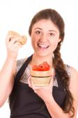 Beautiful young girl eating fresh tomatoes — Stock Photo