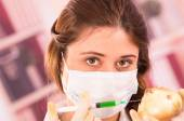 Young beautiful woman biologist experimenting with white onion — Stock Photo