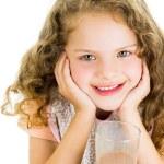 Cute little preschooler girl with chocolate milk mustache — Stock Photo #68869813