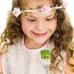 Beautiful healthy little curly girl enjoying eating broccoli — Stock Photo #69047077