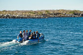 Unidentified tourists on a dinghy going for day tour adventure in the Galapagos Islands — Stock Photo