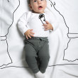 Cute baby boy singer decoration sketch — Stock Photo #70352095