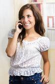 Young beautiful hispanic woman using her cell phone — Stock Photo