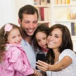 Cute family with two little girls taking a selfie photo — Stock Photo #70689287