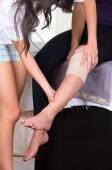 Woman lying while getting a leg massage concept of physiotherapy — Stock Photo