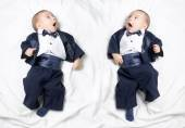 Mirrored photo of cute baby boy wearing an elegant suit with bow tie — Stock Photo