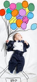 Cute baby boy decorated flying with balloons — Fotografia Stock