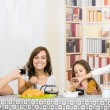 Young sweet parents with two little girls having breakfast — Stock Photo #73117693