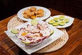 Delicious squid carpaccio plate — Stock Photo