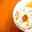 Colorful donuts on plate — Stock Photo #74972819