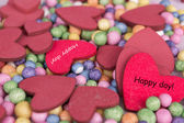 Red hearts background happy day sign — Stock Photo