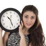 Beautiful young woman holding big round clock — Stock Photo #78758930