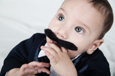 Cute beautiful baby boy in costume with mustache and suit — Stock Photo