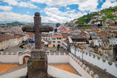 Stone cross decoration belonging to San Diego church with beautiful view showing old part of Quito background — Stock Photo