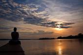 Unidentified tourist in a canoe contemplating stunning rainforest sunset, Yasuni National Park, Ecuador — Stock Photo
