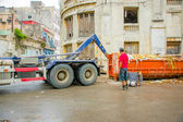 HAVANA, CUBA - DECEMBER 2, 2013: Waste collection vehicle picking up garbage container from the street — Stock Photo