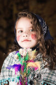 Adorable little girl dressed as a traditional easter witch — Stock Photo