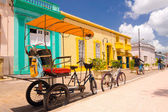 CAMAGUEY, CUBA - SEPTEMBER 4, 2015: bicitaxi is a modified bicycle used for transportation of tourists and goods as a taxi. — Stock Photo