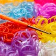 Colorful rubber bands and a hook tool — Stock Photo #68581773