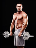 Handsome muscular sportsman isolated — Stock Photo