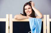 Happy woman looking out from the locker room — Stock Photo