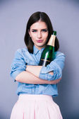 Beautiful cute woman holding bottle of champagne — Stock Photo