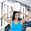 Laughing young fit woman with plastic container on head — Stock Photo #70179223