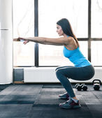 Young woman doing squats — Stock Photo