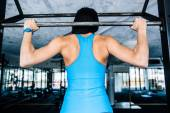 Back view portrait of a woman working out — Foto Stock