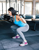 Young fit woman working out with barbell — Stock Photo