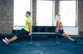 Woman and man doing exercises on hands with bench — Stockfoto