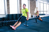 Woman and man workout with hands on bench — Foto de Stock