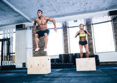 Group of man and woman jumping on fit box — Stock Photo