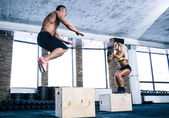 Man and woman jumping on fit box — Stock Photo