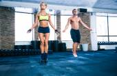 Fitness man and woman workout with jumping rope — Stock Photo