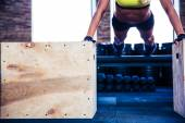 Fit woman doing push ups on fit box — Stockfoto
