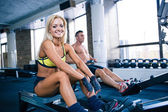 Man and woman workout on training simulator — Stock Photo