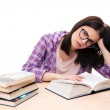 Tired female student sitting at the table — Stock Photo #71646435
