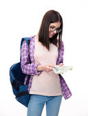 Happy young woman holding bills of dollar — Stock Photo