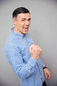 Portrait of a man making victory gesture — Stock Photo