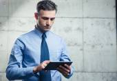 Serious businessman using tablet computer — Stock Photo