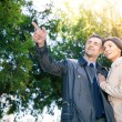 Smiling man pointing on something to his girlfriend — Stock Photo #72929445