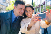 Smiling beautiful couple making selfie photo — Stock Photo