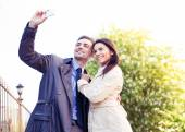 Happy young couple making selfie photo — Stock Photo