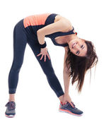 Smiling fitness woman doing stretching exercise — Stock Photo