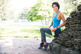 Portrait of a fitness woman resting outdoors — Stock Photo