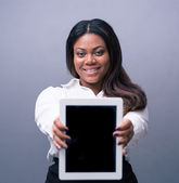 Happy businesswoman showing tablet computer screen — Stock Photo