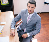 Handsome businessman sitting at the table — Stock Photo